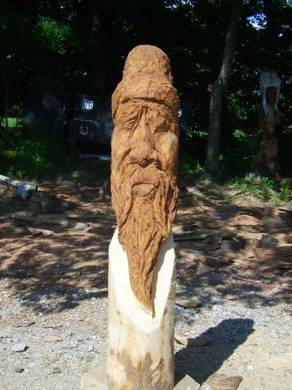 Chainsaw carving of mountain man by becarvings on etsy