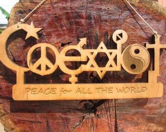 Coexist wall hanging. Promote peace for all.