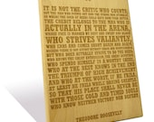 Theodore Roosevelt's famous 'Man in the Arena' quote etched on a Wooden Plaque
