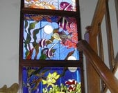 Aquatic Stained Glass panels that fill a floor to ceiling window.