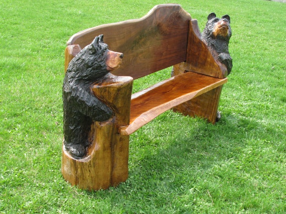 Items similar to chainsaw carved bench with bear ends