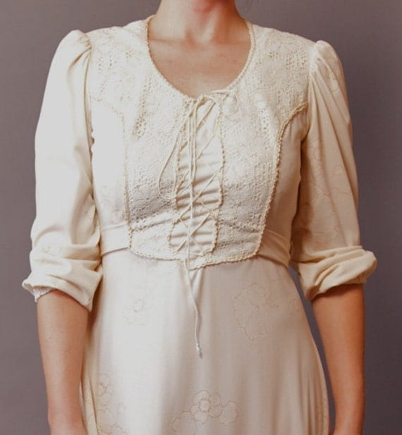 Sweet 1970s wedding dress with lace up bodice.  Size: Medium