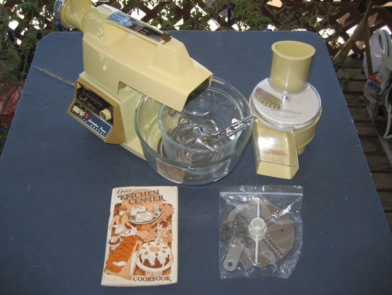 Vintage Oster Kitchen Center With Mixer, Slicer, And Meat Grinder Attachments.