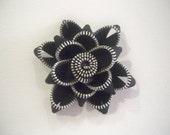 Black zipper flower clip
