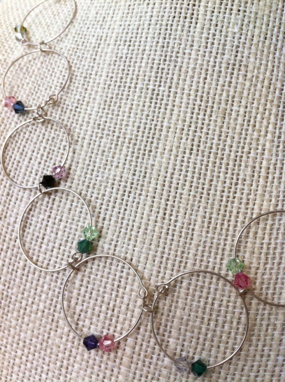 Wire circle necklace embellished with varied color Swarovski crystals