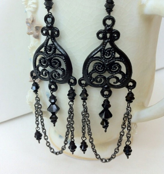 Gothic inspired black earrings with crystals, chain, and filigree piece