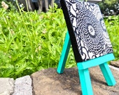 Black & White Flower Design with Bright Turquoise Easel