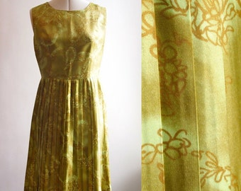 1960's chartreuse green Tricel sleeveless day dress with permanent pleat skirt, lovely leaf/floral pattern, size 11