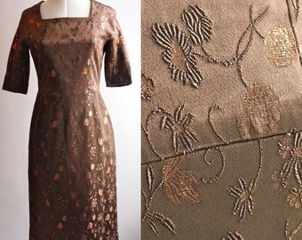 ON SALE 1950's day dress in a heavy brown brocade with metallic thread, square neckline, 3/4 sleeves, size 8-10, label Plumbers Boutique.