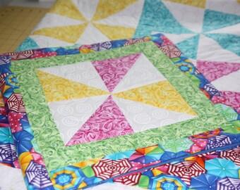Pastel pinwheel quilt with a beachy theme