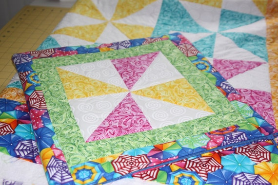 Pastel pinwheel quilt with a beachy theme