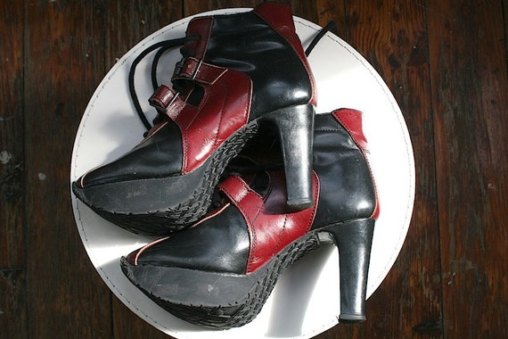 sneaker stilettos . black and red lace up platform heels . athletic high fashion . stompy boots . jeffrey campbell esque