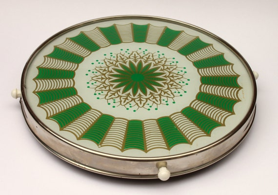 vintage 'lazy susan' with retro green & gold pattern.