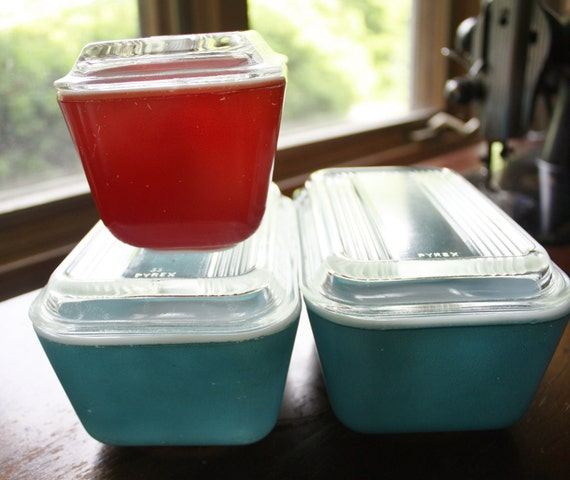 Three Pyrex refrigerator dishes
