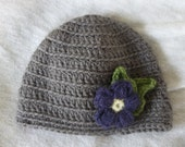 Crochet baby hat with purple flower