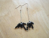 Dangly black seed bead earrings on silver coloured wire