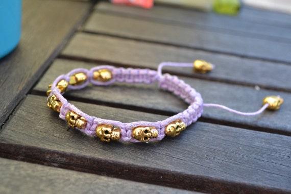Purple Lilac wrap style bracelet with Gold skulls