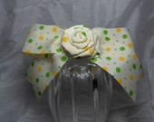 Yellow polka dot boutique ribbon with rose