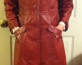 Beautiful long 100% leather  jacket. Size 11