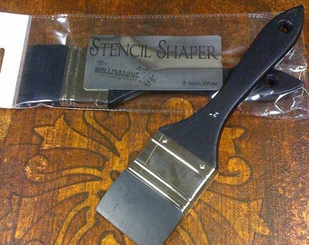 2 inch wide stencil shaper. This rubber squeegee like tool on a paint brush handle is great for use with stencils and even for painting.