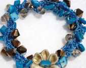Bright Blue Colored Crocheted Beaded Bracelet  with Crystals, Mother of Pearl, that's  Hippy, Beachy, with Lots of Bling
