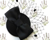 Black veiled cocktail hat, burlesque or vintage style, big black satin bow with spot net veiling