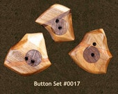 Unique buttons fashioned from cherry, walnut, and oak