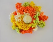 double layered orange yellow white and pale green crochet flower embellishment