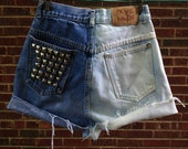 One of a kind bleached, high-waisted, vintage denim shorts with studded pocket detail