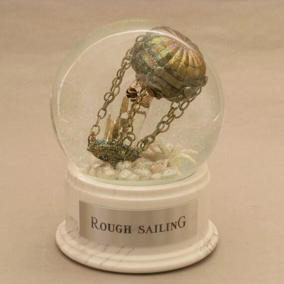 Rough Sailing, air balloon and ship waterglobe