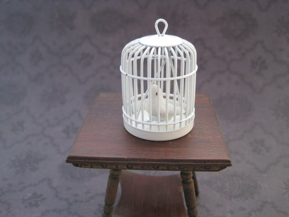 Vintage dollhouse miniature bird in birdcage