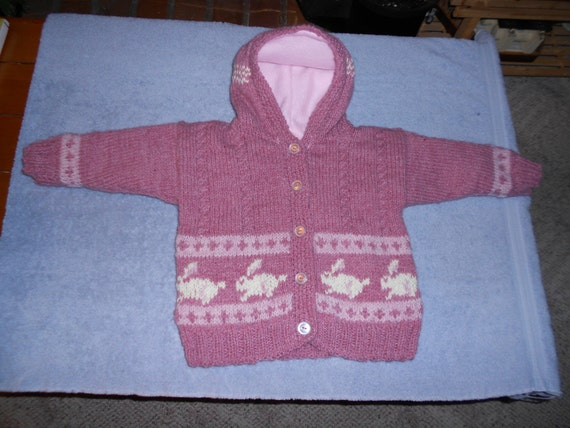 Hooded acrylic/wool bunny sweater-jacket with fleece lining and button-up front.