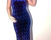 Strapless blue velvet maxi dress.