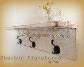 Skelton Signatures White Distressed Shelf featuring Coat Hooks and Mason Flower Vase