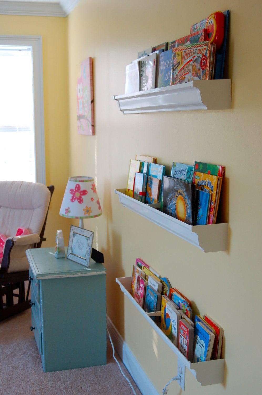 Forward Facing Book Shelf Made Out Of Rain Gutters
