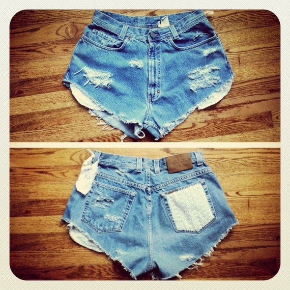 destroyed distressed denim high waisted cut off shorts lace detailing on front pockets under holes and back pocket