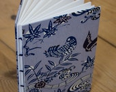 Hand bound notebook with blue and white bird print cover.