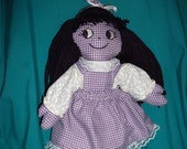"""Purple 18"""" tall doll with dress, pinifore, bloomers."""