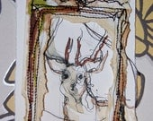 A cute whimsical deer mixed media collage. Original watercolour, fineliner, promarker and stiched piece.