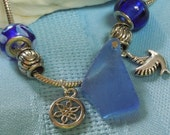 Pandora style charm bracelet with blue sea glass and blue and silver charms