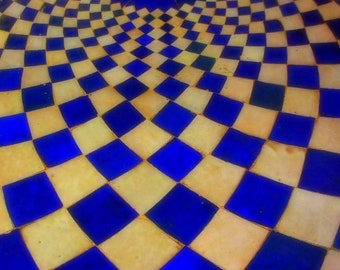 Check.   Indigo Blue and cream checkerboard Moroccan table top with contrast pattern.
