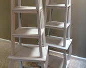 Pair of pagoda shaped etageres or book shelves in dove grey distressed finish