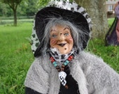 Halloween witch with black and grey cap and grey hair