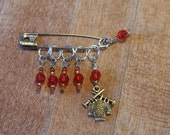 Mrs. Weasley's Red and Gold Knitting Charms