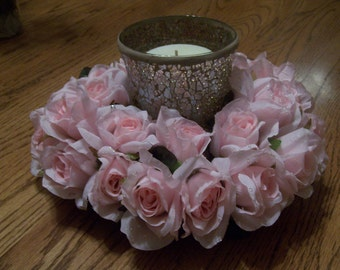 Baby pink roses with dew drops that surround a pink mozaic candle vase