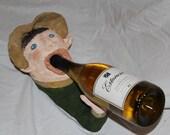 Wine bottle holder sculpture