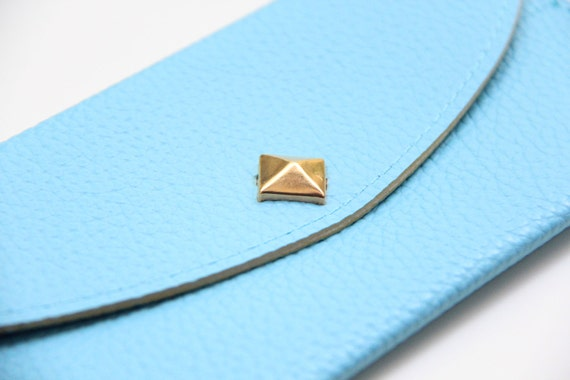 Pale Blue Leather wallet with golden pyramid