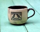 hand thrown mug with transfer design