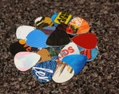 25 guitar picks made out of recycled gift cards, credit cards and other recyclable plastic by Musician