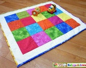 Patchwork baby blanket, handmade in bright and bold colours.
